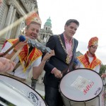 Lord Mayor of Belfast Gavin Robinson is joined by carnival drummers.