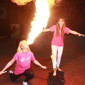 Cathy Martin shows she can handle the heat as she steps over a bed of coals to help launch Cutters Wharf's Firewalking event