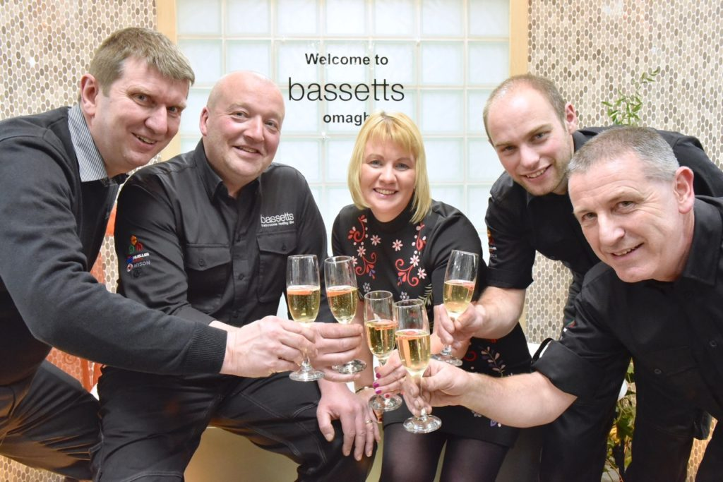 Branch Manager, Trevor Gilfillan, raises a glass to his team, Ivan Crozier, Camelia McWhirther, Nigel Orr and Bob Chambers at the official launch of Bassetts Omagh newly redesigned showroom on Dromore Road.