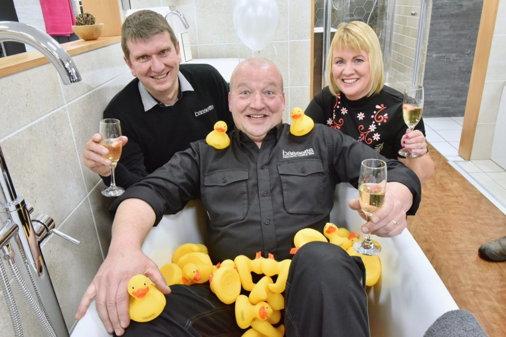 Trevor Gilfillan, Ivan Crozier and Camelia McWhirther pictured at the official launch of the redesigned Bassetts Bathroom store on Dromore Road.