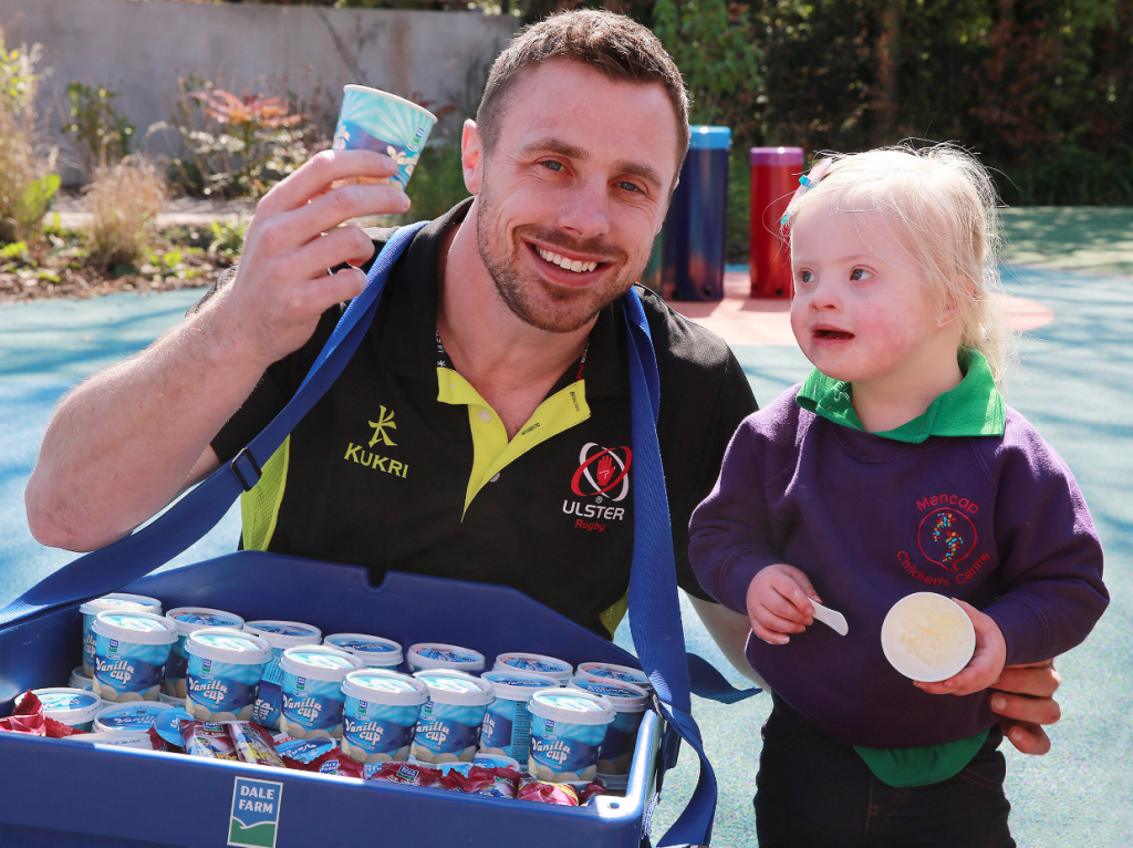 Ulster Rugby player, Tommy Bowe, joins Trinity (3) from Lisburn in the garden of the Mencap Children's Centre for a Dale Farm ice-cream.